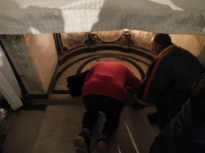 Praying at the site of where John the Baptist was born