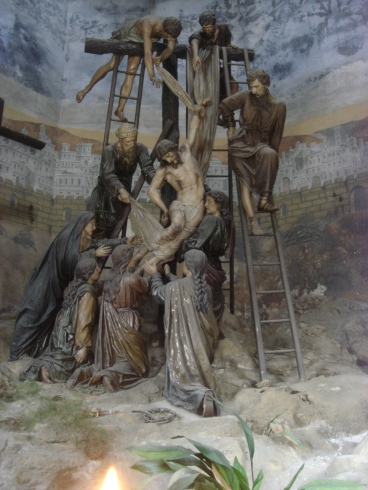 Being taken down from the cross