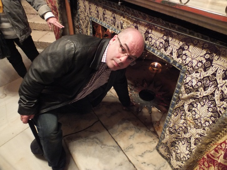 Touching the spot where Jesus was born