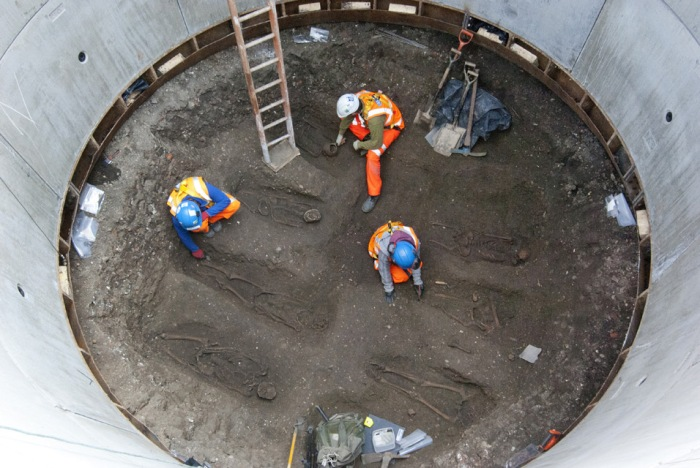 The skeletons at the bottom of the construction shaft