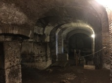 The dark crypt shows remains of older temples